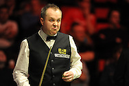 John Higgins of Scotland pulls a face during his match against Judd Trump of England.. Bet Victor Welsh open snooker at the Newport centre in Newport, South Wales on Thursday 27th Feb 2014.<br /> pic by Andrew Orchard, Andrew Orchard sports photography.
