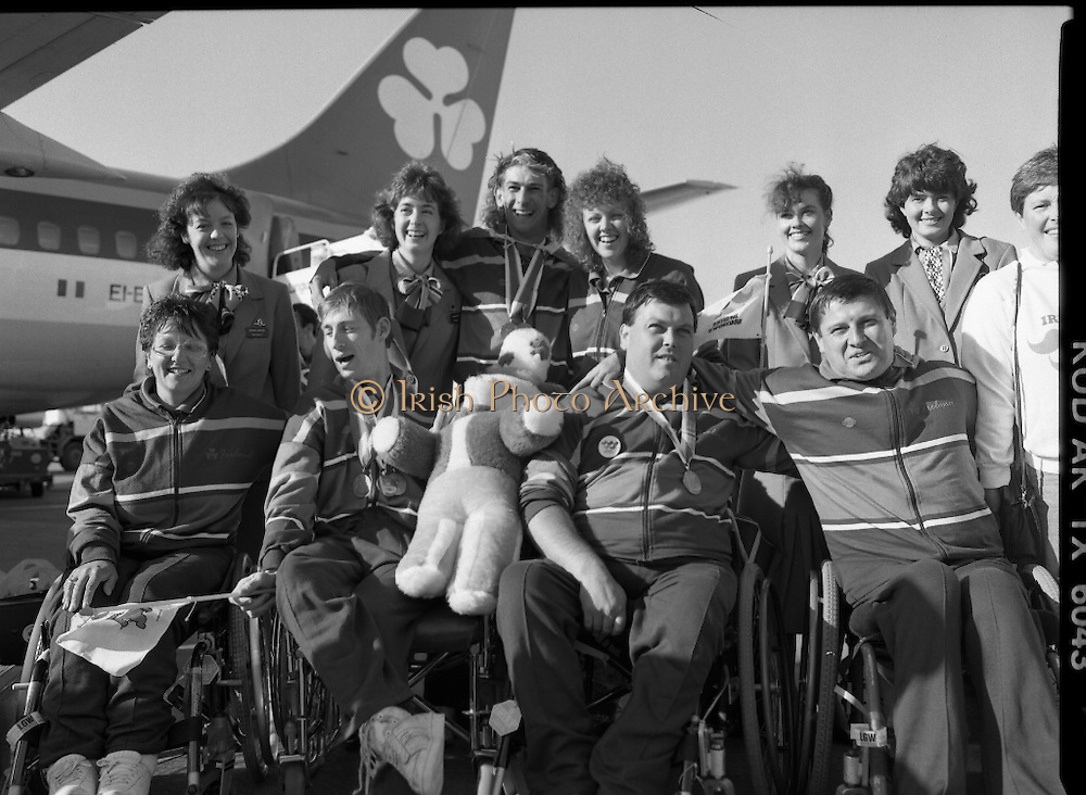 Irish Paralympic Team Arrive Home From Seoul.(R89).1988..28.10.1988..10.28.1988..28th October 1988..The Seoul Summer Paralympics 1988..The very successful Irish Paralympic team arrived home to Dublin today. The team managed a haul of 42 medals, 13 Gold, 11 Silver, 18 Bronze which earned them 19th place in the overall medal table...Pictured on the tarmac at Dublin Airport were members of the Munster contingent of the Irish Paralympic team; (front) Eileen O'Mahoney, Tom Leahy,John Twomey Sean O'Grady and wife Cecelia..(Back) Hostess Finola Murphy, Gwendoline McAllorum, Paul Leisk, Mary Lucey and two un-named Aer Lingus hostesses.
