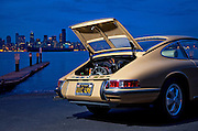 Image of a tan sports car and the Seattle skyline in Seattle, Washington, Pacific Northwest, Porsche 1967 911S, property released by Randy Wells