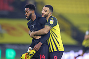Troy Deeney (9) of Watford and Nathaniel Chalobah (14) of Watford celebrate at full time during the EFL Sky Bet Championship match between Watford and Preston North End at Vicarage Road, Watford, England on 28 November 2020.