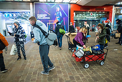 © Licensed to London News Pictures. 25/12/2020. Manchester, UK. Volunteers offer food, hot drinks and Christmas presents to those sleeping rough , on Market Street in Manchester City Centre on Christmas Day . Photo credit: Joel Goodman/LNP