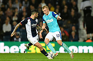 Derby County midfielder Louie Sibley (17) sprints forward with the ball  under pressure from West Bromwich Albion midfielder Alex Mowatt (27) during the EFL Sky Bet Championship match between West Bromwich Albion and Derby County at The Hawthorns, West Bromwich, England on 14 September 2021.