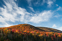 Streaking clouds and peak color in Groton State Forest, Vermont
