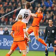NLD/Amsterdam/20121114 - Vriendschappelijk duel Nederland - Duitsland, Mario Gotze in duel met John Heintinga