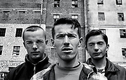 Three young men in a refugee camp at an abandoned warehouse in Shkodra, Albania, April 27, 1999.  The Kosovo Liberation Army is agressively recruiting young men in their campaign against the Serbian Government.