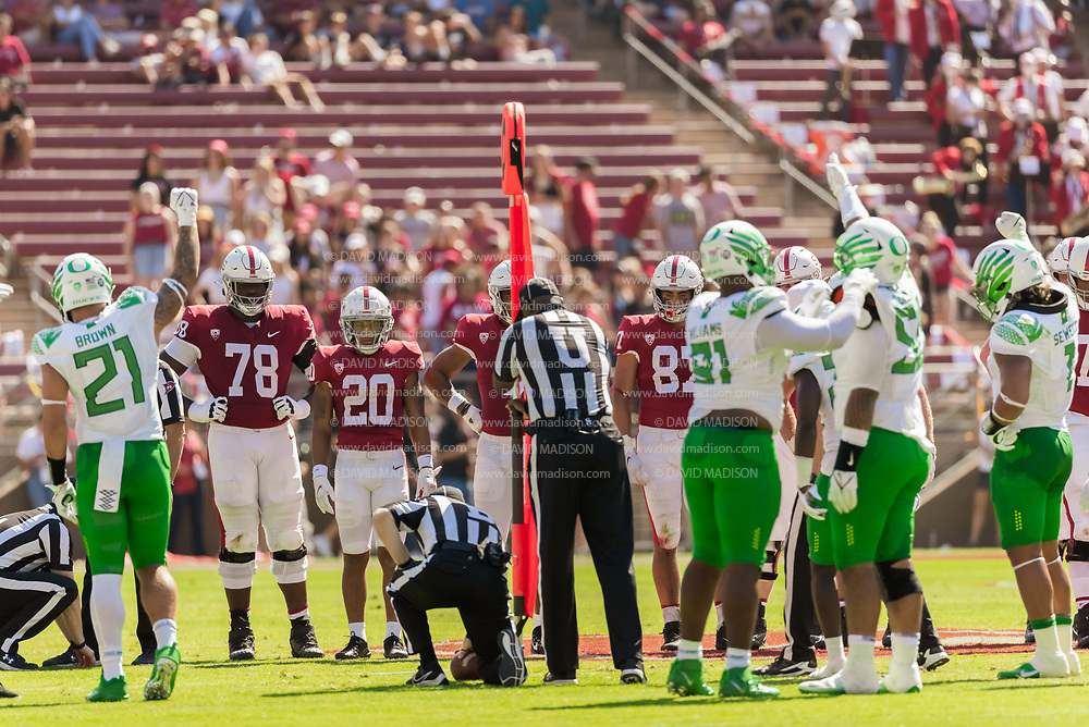 PALO ALTO, CA - OCTOBER 2:  Game officials use the chain markers to measure a play during an NCAA Pac-12 college football game between the Stanford Cardinal and the Oregon Ducks on October 2, 2021 at Stanford Stadium in Palo Alto, California.  (Photo by David Madison/Getty Images)