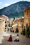 Two young boys sit on the 365 steps of Calvary, Pollenca, in north western Mallorca.