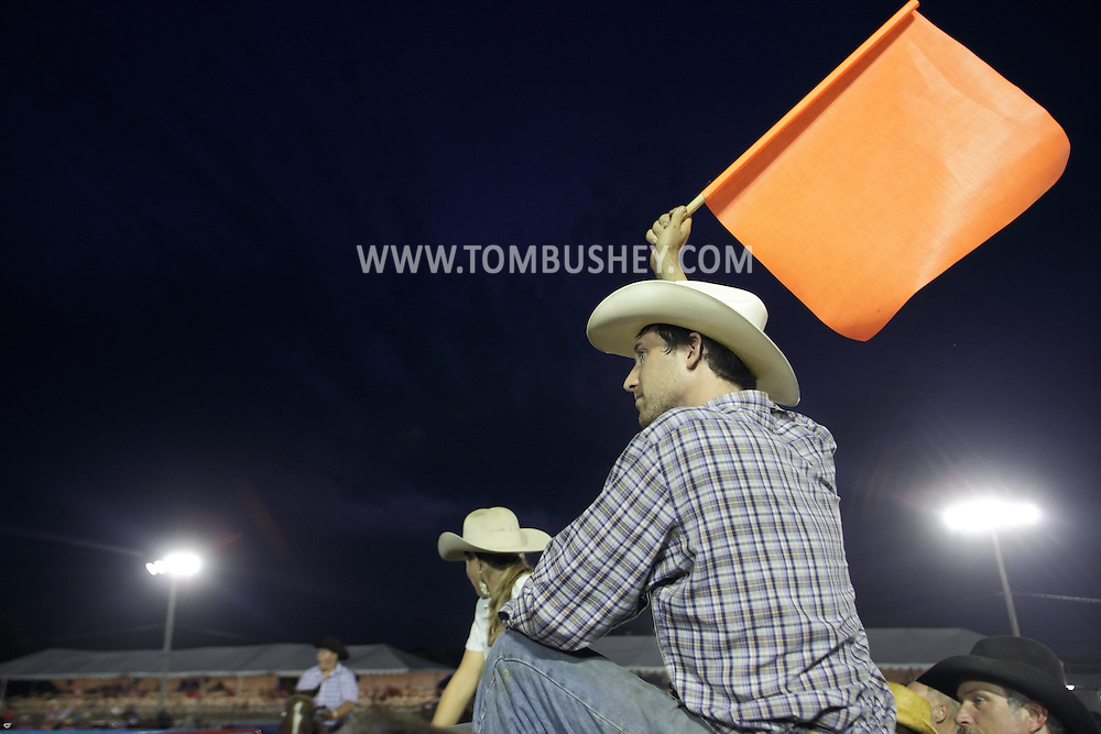 Augusta, New Jersey - A cowboy gets ready to signal that time has expired during the team penning competition at the New Jersey State Fair and Sussex County Farm and Horse Show on Aug. 11, 2010.