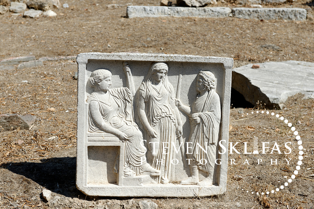 Athens. Greece. View of a stone sculptured relief at the ruins of houses dating from between 5th century BC to 2nd century AD. The ruins border the Sanctuary of the Temple of Olympian Zeus.