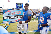 Dec 1, 2012; Tulsa, Ok, USA; Tulsa Hurricanes wide receiver Keyarris Garrett (1) and tailback James Glanders (42) react following a game against the University of Central Florida Knights at Skelly Field at H.A. Chapman Stadium. Tulsa defeated UCF 33-27 in overtime to win the CUSA Championship. Mandatory Credit: Beth Hall-USA TODAY Sports