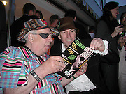 George Melly and Richard Strange. party for memoirs by Richard Strange, penthouse flat, Clarges St. 16 May 2002. © Copyright Photograph by Dafydd Jones 66 Stockwell Park Rd. London SW9 0DA Tel 020 7733 0108 www.dafjones.com