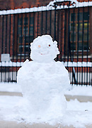 A small snowman on the street in London, UK