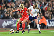 Charlotte Estcourt (17) of Wales holds off Toni Duggan (11) of England during the FIFA Women's World Cup UEFA Qualifier match between England Ladies and Wales Women at the St Mary's Stadium, Southampton, England on 6 April 2018. Picture by Graham Hunt.