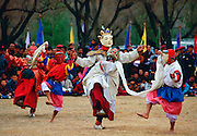 Mask dancing enacting tales of Buddhist legend during a festival in Bhutan