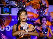 "03 NOVEMBER 2017 - BANGKOK, THAILAND: Entertainers on stage during Loi Krathong at Wat Prayurawongsawat on the Thonburi side of the Chao Phraya River. Loi Krathong is translated as ""to float (Loi) a basket (Krathong)"", and comes from the tradition of making krathong or buoyant, decorated baskets, which are then floated on a river to make merit. On the night of the full moon of the 12th lunar month (usually November), Thais launch their krathong on a river, canal or a pond, making a wish as they do so. Loi Krathong is also celebrated in other Theravada Buddhist countries like Myanmar, where it is called the Tazaungdaing Festival, and Cambodia, where it is called Bon Om Tuk.     PHOTO BY JACK KURTZ"