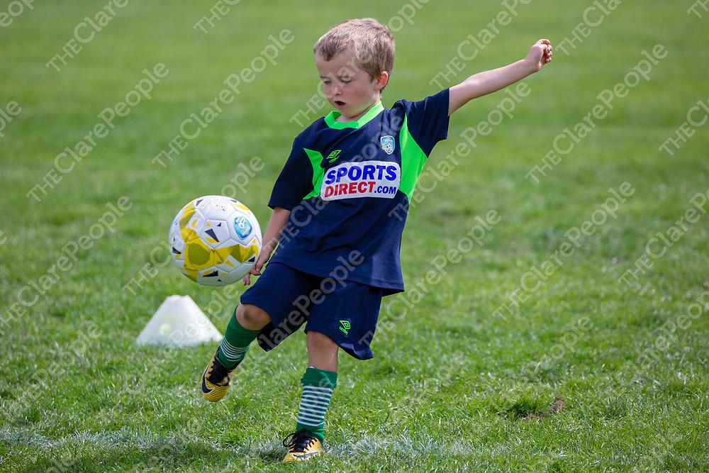 Aaron Quirke from Ruan takes a shot at goal at the FAI Soccer Camp at John O'Sullivan Park, Lees Road