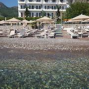 Empty Diplomat hotel beach in Turunc Marmaris, Turkey
