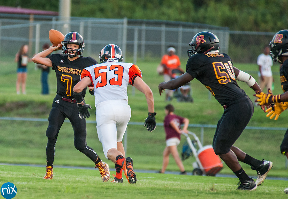 Jay M. Robinson's Josh Dale (7) looks to pass against Northwest Cabarrus Friday night at Jay M. Robinson High School in Concord.