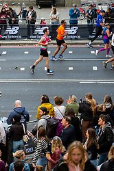 © Licensed to London News Pictures. 03/10/2021. LONDON, UK. Spectators cheer runners on Embankment passing mile 25 in the London Marathon, the first time it has been held since April 2019 due to the Covid-19 pandemic.  Over 36,000 elite athletes, club runners and fun runners are taking part in the mass event, with another 40,000 people taking part virtually.  Photo credit: Stephen Chung/LNP
