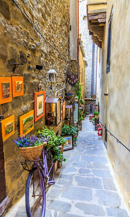 An alley with art in Cortona, Italy.