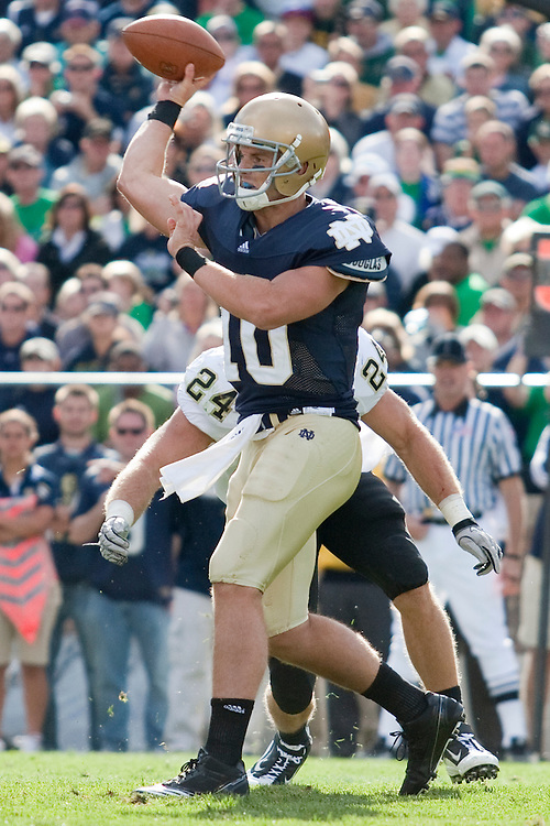 Notre Dame quarterback Dayne Crist (#10) delivers pass in game action during NCAA football game between the Notre Dame Fighting Irish and the Purdue Boilermakers.  Notre Dame defeated Purdue 23-12 in game at Notre Dame Stadium in South Bend, Indiana.