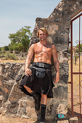 sexy man without a shirt in a kilt