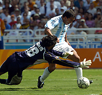 28/08/04 - ATHENS - GREECE -  - OLYMPIC FOOTBALL - FINAL MATCH - MENS  -  At the Olympic Stadium in Athens<br />ARGETNINA (1) win over PARAGUAY (0).<br />Argentine player N* 10 CARLOS TEVEZ second chance over GK. N*18 BARRETO.<br />© Gabriel Piko / Argenpress.com / Piko-Press