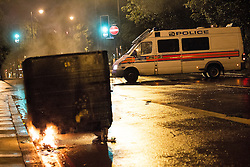 © Licensed to London News Pictures . 08/08/2011 . London , UK . Police in Brixton during a 2nd night of rioting and looting in London , which followed a protest against the police shooting of Mark Duggan in Tottenham . Photo credit : Joel Goodman/LNP