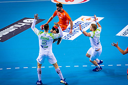 The Dutch handball player Jorn Smits in action against Nik Henigman from Slovenia during the European Championship qualifying match on January 6, 2020 in Topsportcentrum Almere