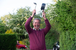 ©Licensed to London News Pictures 07/05/2020  <br /> Downe, UK. Politician, broadcaster and Brexit party leader Nigel Farage banging on his saucepan for the NHS outside his Kent home this evening at 8pm. Photo credit:Grant Falvey/LNP