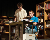 """Brittney Pond as """"Maggie"""" and Reese Miles as """"David"""" make a discovery during LHS Theater Arts' dress rehearsal for """"Letters From My Father"""" Wednesday evening at Laconia High School.  (Karen Bobotas/for the Laconia Daily Sun)"""