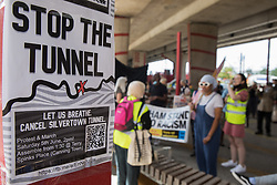 London, UK. 5th June, 2021. Environmental activists and local residents assemble in Canning Town for a protest against the construction of the Silvertown Tunnel. Campaigners opposed to the controversial new £2bn road link across the River Thames from the Tidal Basin Roundabout in Silvertown to Greenwich Peninsula argue that it is incompatible with the UK's climate change commitments because it will attract more traffic and so also increased congestion and air pollution to the most polluted borough of London.