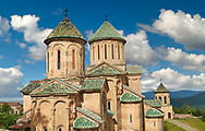 Pictures & images of Gelati Georgian Orthodox churches of (foreground) St George, 13th century, (behind) Church of the Virgin, 1106. The medieval Gelati monastic complex near Kutaisi in the Imereti region of western Georgia (country). A UNESCO World Heritage Site. .<br /> <br /> Visit our MEDIEVAL PHOTO COLLECTIONS for more   photos  to download or buy as prints https://funkystock.photoshelter.com/gallery-collection/Medieval-Middle-Ages-Historic-Places-Arcaeological-Sites-Pictures-Images-of/C0000B5ZA54_WD0s<br /> <br /> Visit our REPUBLIC of GEORGIA HISTORIC PLACES PHOTO COLLECTIONS for more photos to browse, download or buy as wall art prints https://funkystock.photoshelter.com/gallery-collection/Pictures-Images-of-Georgia-Country-Historic-Landmark-Places-Museum-Antiquities/C0000c1oD9eVkh9c