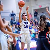 Miyamura Patriot Odessa Begaye (10), center attempts a three-point basket on the Gallup Bengals at Miyamura High School Thursday.