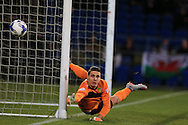 Leeds Utd goalkeeper Marco Silvestri dives  to save a free-kick taken by Peter Whittingham in the 1st half. Skybet football league championship match, Cardiff city v Leeds Utd at the Cardiff city stadium in Cardiff, South Wales on Tuesday 8th March 2016.<br /> pic by  Andrew Orchard, Andrew Orchard sports photography.