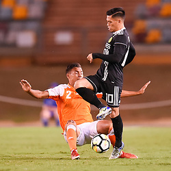 BRISBANE, AUSTRALIA - JANUARY 23: Jose Elmer Porteria of Ceres Negros is tackled by Dane Ingham of the Roar during the AFC Champions League Second Preliminary Round match between Brisbane Roar and Ceres Negros FC on January 23, 2017 in Brisbane, Australia. (Photo by Patrick Kearney)