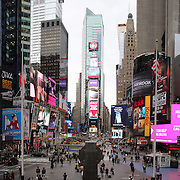 """A panoramic view of Times Square, the major commercial intersection in Midtown Manhattan, New York City, at the junction of Broadway and Seventh Avenue and stretching from West 42nd to West 47th Streets. Times Square, iconified as """"The Crossroads of the World"""" is the brightly illuminated hub of the Broadway theater district and one of the world's busiest pedestrian intersections. Times Square, New York, USA. Photo Tim Clayton.Note to Editors. This image is a composite of two images taken a split second apart and merged in editing."""