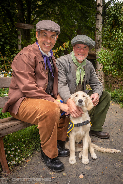 Garden designers Jonathan Smith and Adam Woolcott  in the Artisan Garden with puppy Chelsea at RHS Chelsea which they created this year in celebration of 90 years of guide dog partnerships in Britain. The garden has been created this year in celebration of 90 years of guide dog partnerships in Britain. Chelsea is 18 weeks-old and named to celebrate the event.<br /> Picture date: Monday September 20, 2021.<br /> Photograph by Christopher Ison ©<br /> 07544044177<br /> chris@christopherison.com<br /> www.christopherison.com