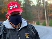 """Jim Blow lined up to vote before the polls open. As a local Oneida Township committee member, his job for the day is to hand out """"I voted"""" stickers."""