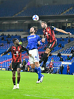 Football - 2020 / 2021 Sky Bet Championship - Cardiff City vs AFC Bournemouth - Cardiff City Stadium<br /> <br /> Sean Morrison of Cardiff City & Steve Cook of Bournemouth head the ball<br /> in a match played without fans<br /> <br /> COLORSPORT