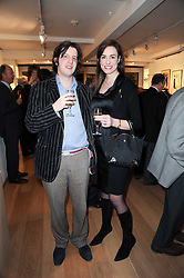 PHILIP WOMACK and GALLIA GRIMSTON at a private view of recent paintings, drawings and prints by Dione Verulam (Countess of Verulam) held at Sladmore Contemporary art gallery, 32 Bruton Place, London on 10th February 2010.