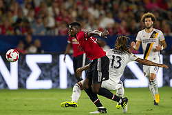 July 15, 2017 - Carson, California, U.S - Manchester United M Paul Pogba (6) and Los Angeles Galaxy M Jermaine Jones (13) in action during the summer friendly between Manchester United and the Los Angeles Galaxy at the StubHub Center. (Credit Image: © Brandon Parry via ZUMA Wire)
