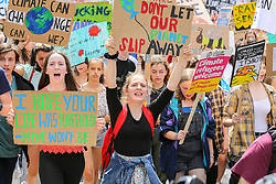 © Licensed to London News Pictures. 24/05/2019. London, UK. Hundreds of students demonstrates by marching through Whitehall for Youth Strike 4 Climate Change Protest demanding the UK Government to declare a climate emergency. Photo credit: Dinendra Haria/LNP