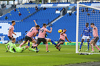 Football - 2020 / 2021 Premier League - Brighton and Hove Albion vs. Sheffield United - The Amex Stadium<br /> <br /> George Baldock of Sheffield United gets a block on Alireza Jahanbakhsh of Brighton rebounded effort on goal to stop a last minute winner for Brighton at The Amex Stadium Brighton <br /> <br /> COLORSPORT/SHAUN BOGGUST