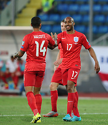 Theo Walcott of England (Arsenal) celebrates his goal with Fabian Delph of England (Manchester City)  - Mandatory byline: Joe Meredith/JMP - 07966386802 - 05/09/2015 - FOOTBALL- INTERNATIONAL - San Marino Stadium - Serravalle - San Marino v England - UEFA EURO Qualifers Group Stage