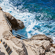 An isolated place to relax and enjoy the view of the sea below the walls of the old city of Dubrovnik, Croatia.