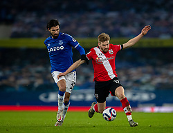 LIVERPOOL, ENGLAND - Monday, March 1, 2021: Southampton's Stuart Armstrong is held back by Everton's André Gomes during the FA Premier League match between Everton FC and Southampton FC at Goodison Park. Everton won 1-0. (Pic by David Rawcliffe/Propaganda)