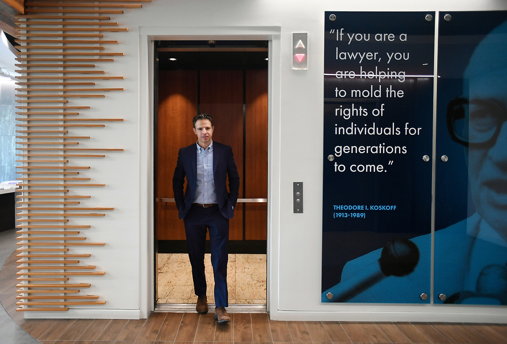 Attorney Josh Koskoff, steps out of an elevator next to a photograph of his grandfather, attorney Theodore Koskoff, at the office of Koskoff, Koskoff & Bieder, Thursday, Nov. 9, 2017 in Bridgeport, Conn. Koskoff is part of a legal team representing families from Newtown.(Jessica Hill for the New York Times)