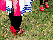 Young Hmong Der (White Hmong) women wearing contemporary Hmong traditional costume at Ban Km 52 Hmong New Year festival, Vientiane province, Lao PDR. The Hmong celebration of New Year is based on the lunar calendar. This important time is an opportunity to honour ancestors and spirits through offerings and rituals and to partake in games, sports, feasts, shows, bullfights and courtship. The Hmong are the third largest ethnic group in Laos. One of the most ethnically diverse countries in Southeast Asia, Laos has 49 officially recognised ethnic groups although there are many more self-identified and sub groups. These groups are distinguished by their own customs, beliefs and rituals.