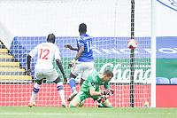 LEICESTER, ENGLAND - JULY 04: Kelechi Iheanacho of Leicester City places the ball in to the net ahead of Mamadou Sakho of Crystal Palace and Crystal Palace goalkeeper Vicente Guaita during the Premier League match between Leicester City and Crystal Palace at The King Power Stadium on July 4, 2020 in Leicester, United Kingdom. Football Stadiums around Europe remain empty due to the Coronavirus Pandemic as Government social distancing laws prohibit fans inside venues resulting in all fixtures being played behind closed doors. (Photo by MB Media)